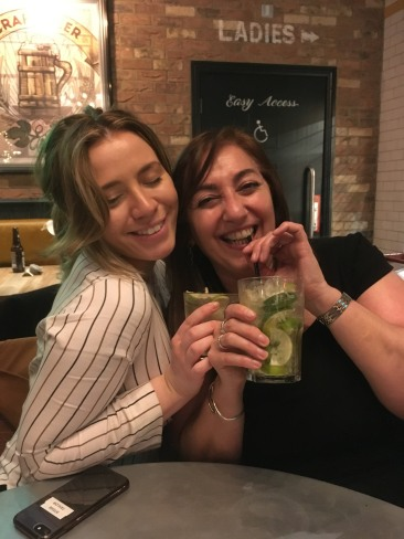Two women drinking cocktails
